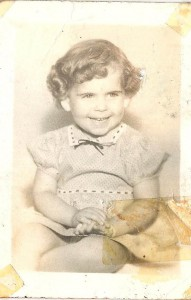This may be old and tattered but I do have it! Not sure what my mother was THINKING with the curls though.
